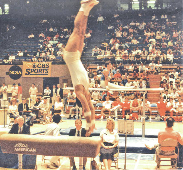 Mike Willson, a 1955 Hillsboro High School graduate, springs off the vault horse during his collegiate career at Ohio State University.