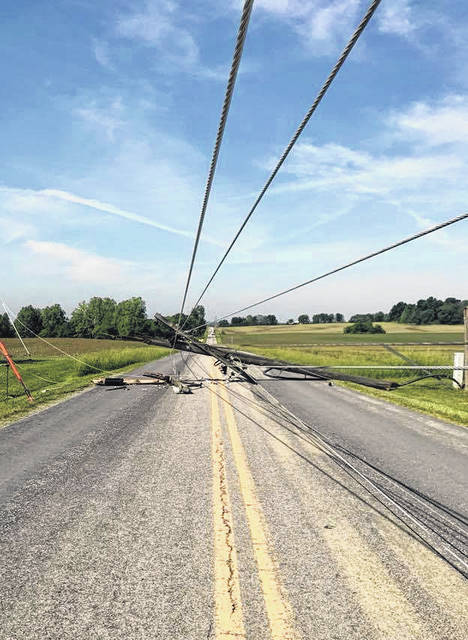 High winds downed this utility pole and six others on Petersburg Road outside Hillsboro, according to AEP Ohio.