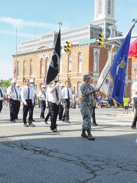Members of the Concerned Veterans of Greenfield march on Monday in Greenfield's Memorial Day parade. Memorial Day observances in Greenfield included the parade, a presentation by the Concerned Veterans of Greenfield and a dedication of veterans banners placed around the village.