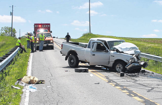 The driver of the white pickup truck was pronounced dead Wednesday after the vehicle collided with a Highland County Engineer dump truck, authorities said.