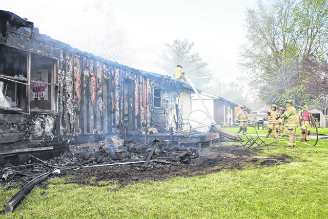 A Linkhart Drive residence in New Vienna sustained heavy damage after flames consumed the rear of the home, drawing firefighters from three departments to battle the blaze. Captain Alan Henderson of the Clinton-Highland Joint Fire District told The Times-Gazette on scene that the fire appeared to have started in the rear corner of the residence, but the exact cause was undetermined. Firefighters with CHJFD, Paint Creek Joint EMS/Fire District and the Martinsville Fire Department responded. There were no reported injuries. No further information was immediately available at the scene.