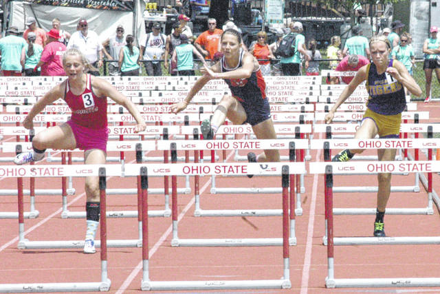 Chayden Pitzer, far right, begins to jump over the final hurdle on Saturday in the D II girl's 100-meter hurdles finals at Jesse Owens Memorial Stadium on the campus of Ohio State University in Columbus.