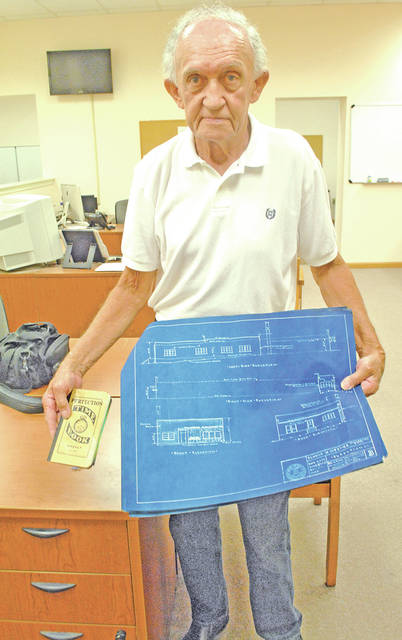 """During The Times-Gazette 200th birthday celebration Monday, Hillsboro resident Bob Dunlap brought in the original plans for the newspaper's former location in the 200 block of South High Street in Hillsboro. He also had the """"time book"""" his father, Robert """"Todd"""" Dunlap used while managing the project. Bob's grandfather, Clyde Dunlap, also worked on the building that was built in 1955 for the Hillsboro Publishing Company. Inside the time book are these words penned by Todd Dunlap: """"Very modern. Hot water & A/C. Glazed tile to the ceiling except in offices and warehouse. Prefinished brick paneling in offices – acoustical tiled ceilings."""""""