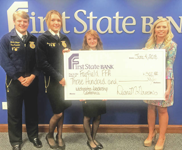 Pictured, from left, are Fairfield FFA students Braden Heizer, Bianna Burleson and Teigan Thackston, and Diana Grooms, manager of the First State Banking Center in Hillsboro.