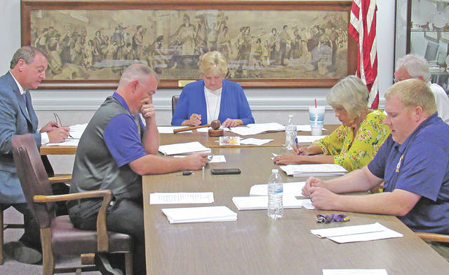 Greenfield Exempted Village Schools Board of Education members are pictured (l-r) at Tuesday's meeting: Jason Allison, Sandy Free, Marilyn Mitchell and Charley Roman. Pictured to the far left is superintendent Joe Wills, and behind Mitchell is treasurer Joe Smith.