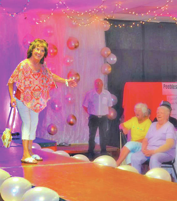 Highland County Senior Citizens member Jackie Noble models on the runway during last year's Ladies Day Out Fashion Runway Show.