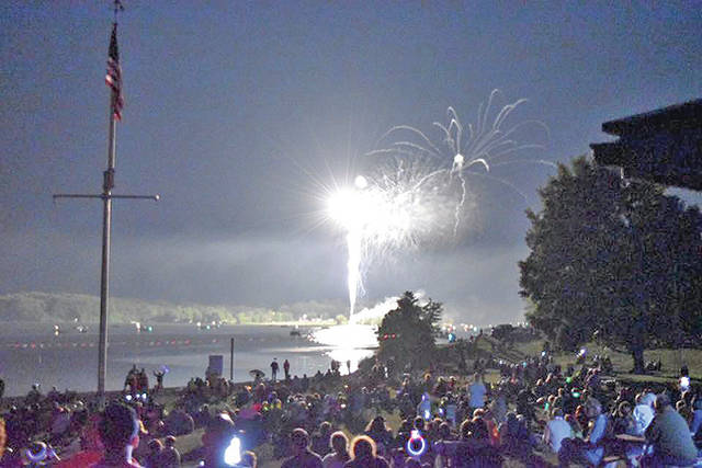 A portion of the North Beach crowd is visible as fireworks explode over Rocky Fork Lake during a past Poppin' and Rockin' at the Lake event.