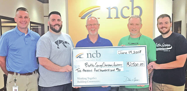 NCB recently donated $2,500 to Butler Springs Christian Camp. With approximately 8,500 people visiting Butler Springs Christian Camp & Retreat Center each year, the money will be used to help provide smaller, more unique meeting areas for guests. Pictured, from left, are: Dave Smith, NCB facilities manager; Chris Osborne, Butler Springs Retreat coordinator; Keith Warner, camp director; Gus Denzik, facilities director; and Matt James, program director.