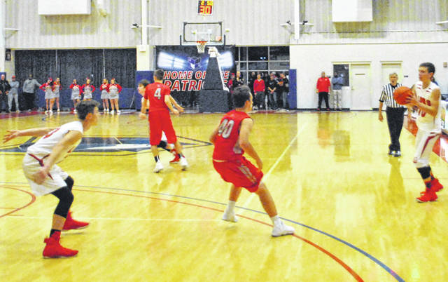 In this file photo outgoing senior Cody Gragg handles the ball on the wing as incoming senior Sam Buddelmeyer maneuvers into position in the post.
