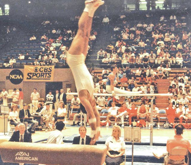 Mike Willson springs off the vault horse during his collegiate career at Ohio State.