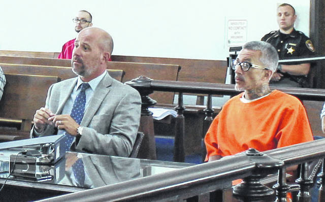 Stoney Behler, right, sits in Highland County Common Pleas Court on Friday with attorney J.D. Wagoner.