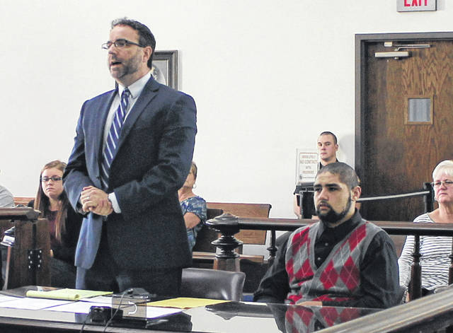 Benjamin McClellan, right, sits in Highland County Common Pleas Court on Thursday as defense attorney Adam Burke, left, argues on his behalf.