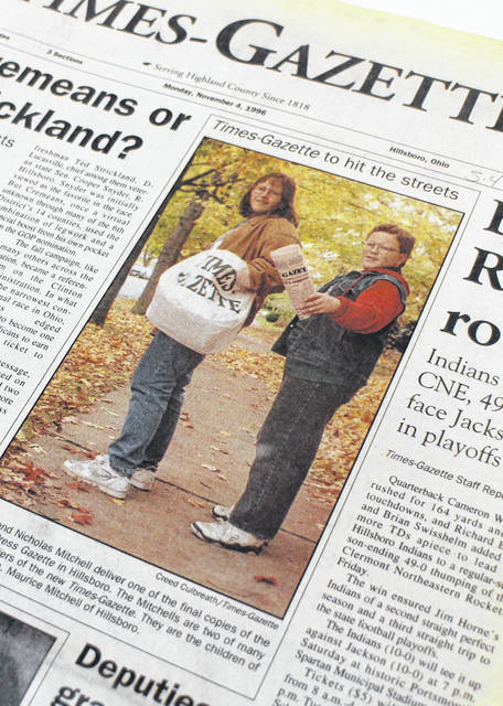 Audra and Nicholas Mitchell are shown on the front page of the first edition of The Times-Gazette, which was formed when the Hillsboro Press-Gazette merged with the Greenfield Daily Times in 1996. The siblings are shown carrying the last copies of the Press-Gazette before the switch, the new name already reflected on the bags they were carrying.