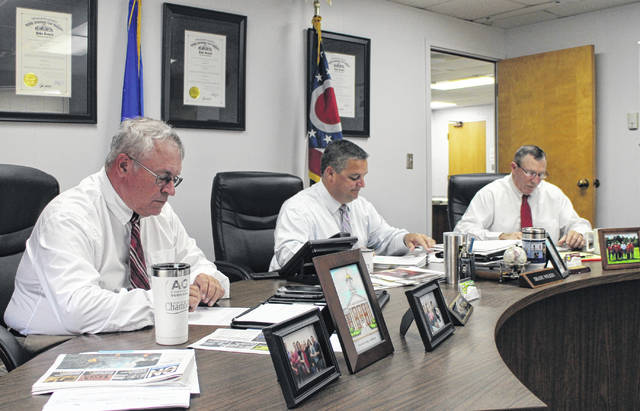 From left to right, Highland County commissioners Jeff Duncan, Shane Wilkin and Terry Britton sit in session during their weekly meeting on Wednesday.