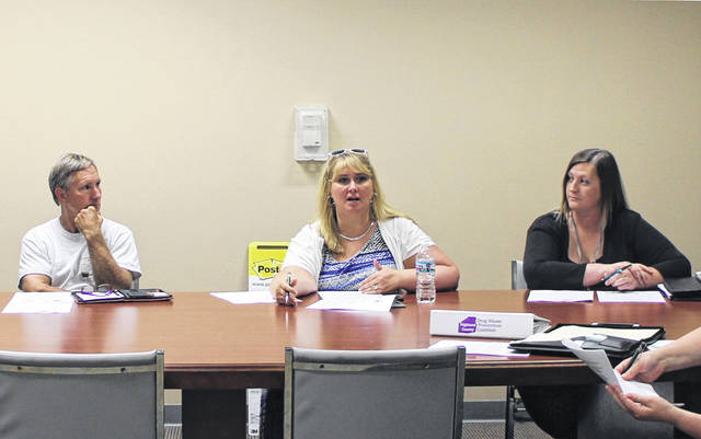 Highland County Drug Abuse Prevention Coalition President and REACH for Tomorrow CEO Heather Gibson, center, speaks to the coalition on Thursday. Also shown are Pastor Kim Zornes of Carpenter's House of Prayer, left, and Danielle Poe of REACH for Tomorrow, right.