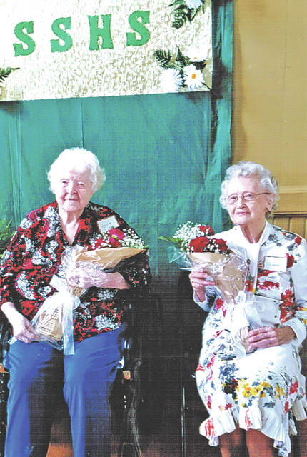Viola (Rhoads) Riley, left, and Venita (Shanks) Bennett, both 100 years old, are pictured at last month's annual Sinking Spring High School Reunion.