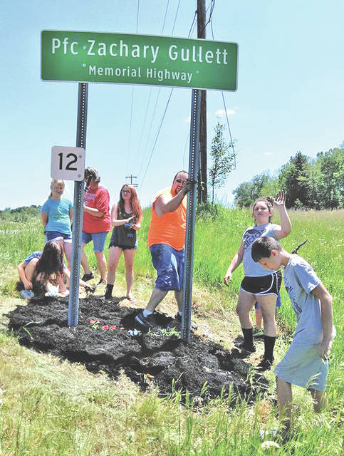 Members of the Highland County Buckeyes 4-H Club are pictured during a community service project earlier this year.