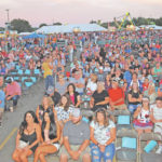 Crowd files in for Festival of the Bells Dylan Scott concert Friday