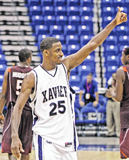 In this 2008 file photo Xavier's Dante Jackson gives a thumbs up to the crowd in Puerto Rico where the Musketeers beat the Virginia Tech Hokies. Jackson was hired as an assistant coach on Wednesday by the Musketeers returning to Xavier four years after departing the school after three years as a graduate assistant.