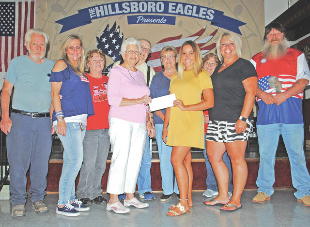 Emily Loudin, a 2018 graduate of Hillsboro High School who will be attending Xavier University, recently received a $1,000 scholarship from the Highland County Eagles Past Presidents Club. Loudin (center), the daughter of Phil and Heather Loudin, is shown being presented with the check by Gladys Watson. Also pictured, in no particular order, are Heather Loudin, Darlene Reid-Rericha, Tim Tabor, Tommy Roush, Debbie Martin, Ed Crable, Hugh Stultz and Misty Tarr.