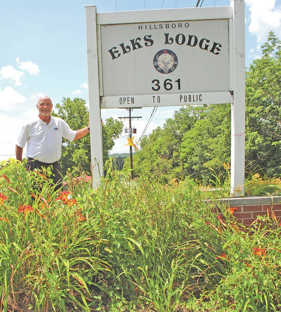 Exulted Ruler John Hern stands beside a sign near the entrance to the Hillsboro Elks Lodge at 451 Danville Pike.