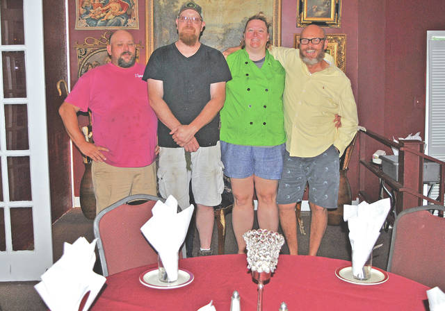 The four partners running The Frog and Club are shown inside the restaurant at the Hillsboro Elks Lodge, from left, Doug Gall, Brad Calhoun, Avery Elliott and Tim Richardson.