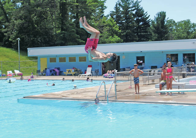 Ethan Snapp springs off the diving board Tuesday afternoon at the Hillsboro Swim Club.