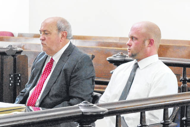 Justin Anderson, right, sits in court on Thursday with attorney Bruce Wallace.
