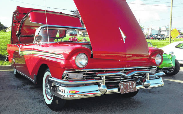 This cherry red 1957 Ford Fairlane 500 Skyliner with a retractable metal top, owned by Ray Martin of Mowrystown, is shown at a cruise-in last week in the parking lot at Advance Auto Parts in Hillsboro.