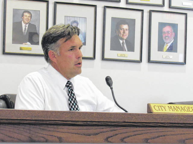 Greenfield City Manager Todd Wilkin speaks to the village council at its meeting on Tuesday.