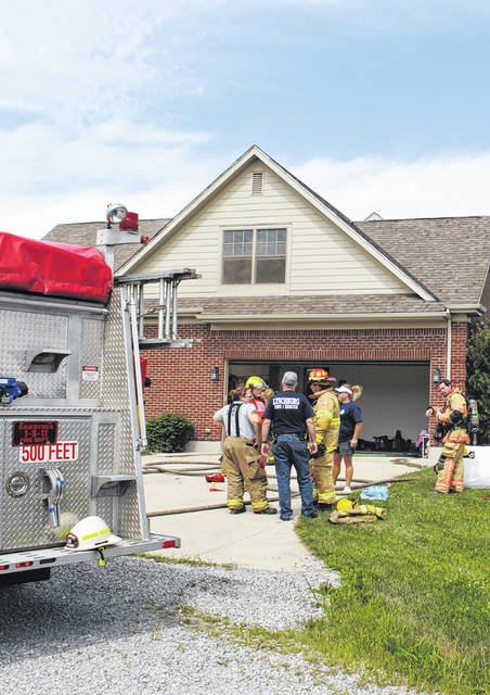 Firefighters are shown at the scene of a house fire on SR 138 near Buford Thursday afternoon.
