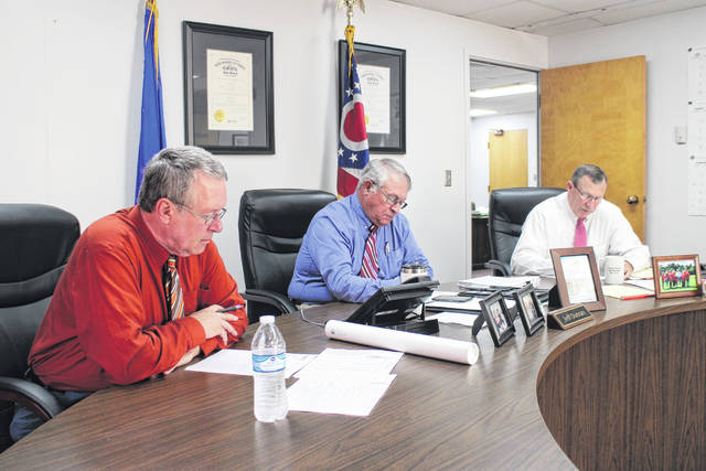 From left, Highland County commissioners Gary Abernathy, Jeff Duncan and Terry Britton sit in session during their weekly meeting Wednesday.