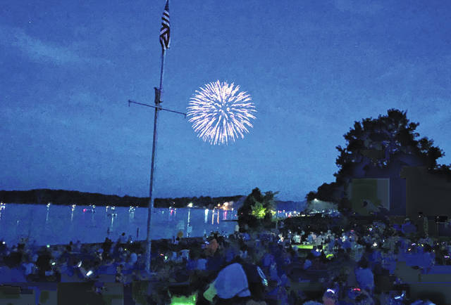 A large crowd watches fireworks at Rocky Fork Lake on Saturday. Organizers said the event drew roughly 5,000 people.