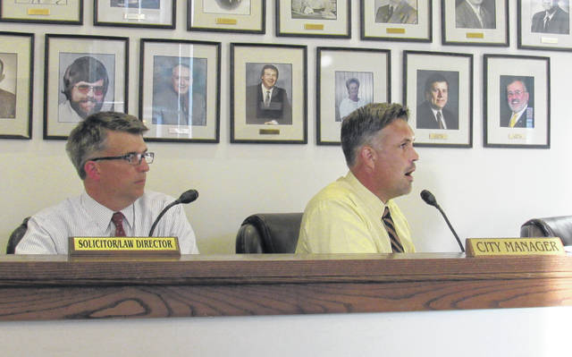Greenfield Law Director Brian Zets, left, and City Manager Todd Wilkin, right, are pictured during Tuesday's council meeting.