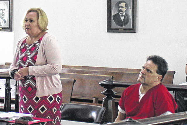 Joel Williams, right, sits in court with defense attorney Kathryn Hapner on Monday.