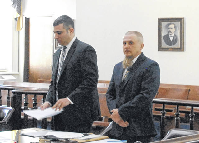 Jason Leston, right, stands in Highland County Common Pleas Court Friday with defense attorney Scott Evans.