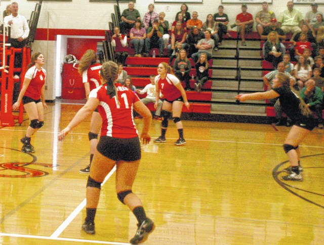 In this Times-Gazette file photo current Fairfield senior volleyball players Kami Magee (far left) and Lauren Arnold (far right) look to hit the ball in a 2017 match.