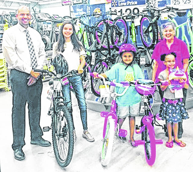 Pictured are winners from the Greenfield Library Summer Reading Program, from left, Joshua McCoy from Greenfield Adena Medical Center, Macy Keeton, Jenna Jenkins, Kallista Hennison and Sharon Aukeman, branch manager. The girls won bikes by participating in the Adena Healthy Kids summer reading activity log.