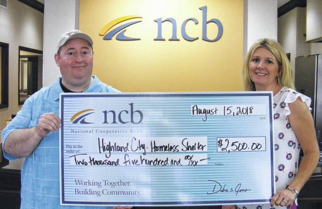 NCB recently donated $2,500 to the Highland County Homeless Shelter, which provides safe, temporary housing for homeless individuals and families and aids those homeless with the resources and referrals that will help them obtain and maintain permanent housing. Pictured are Greg Hawkins, (left) executive director of the homeless shelter, and Heather Cummings, NCB marketing manager.