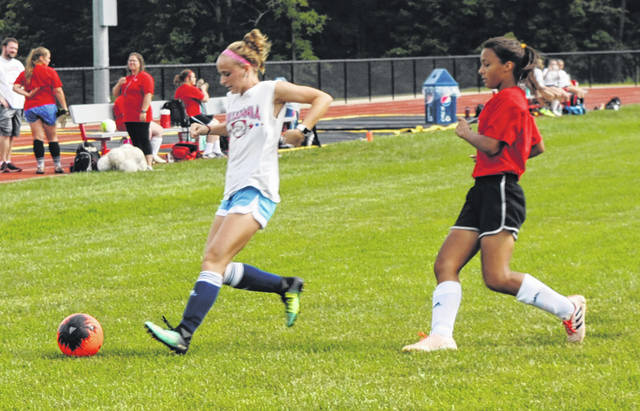 Two Hillsboro girls soccer players battle one another in practice at Hillsboro High School.
