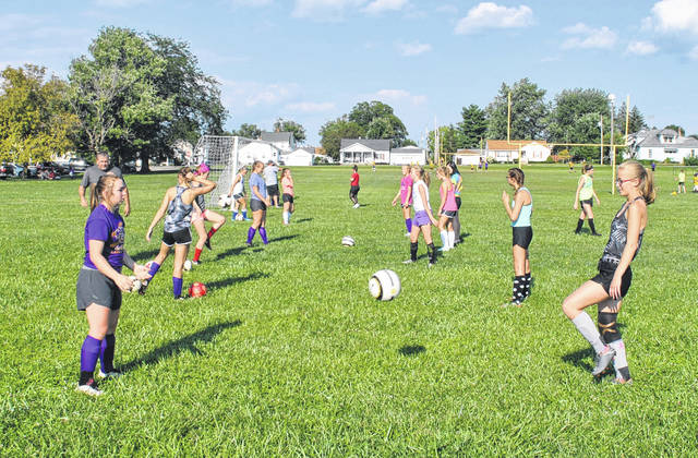 The McClain girls varsity Soccer team is pictured practicing at the McClain High School practice field in Greenfield.