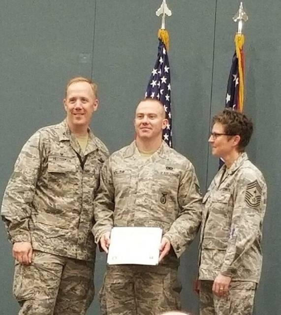 Presenting Brandan Holiday (center) with his degree are Gregg J. Hesterman (left) colonel 178th wing, base commander; and Heidi A. Bunker, command chief master sergeant of 178 wing.