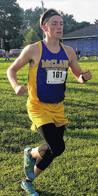 McClain's Reece Schluep runs on Wednesday at the McClain Invitation held at Mitchell Park in Greenfield.