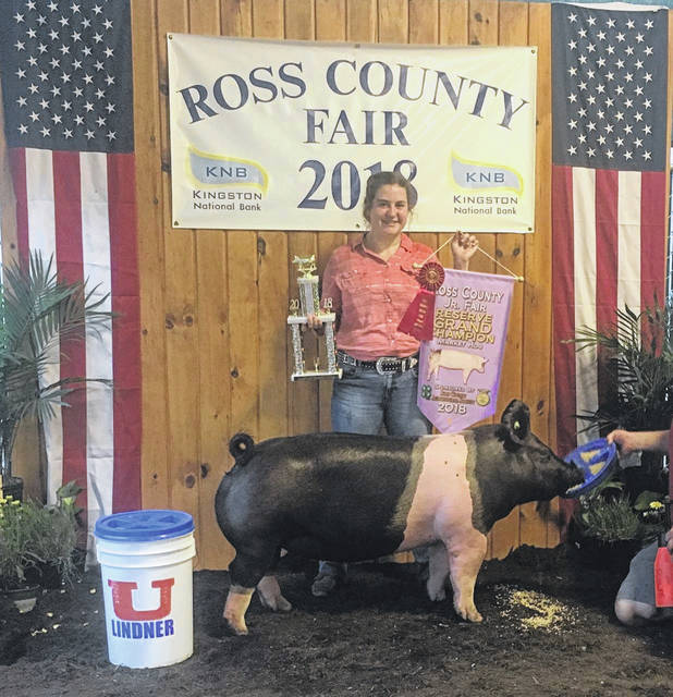 Natalie Rolfe, a member of the Buckskin Ramblers 4-H Club who will be a junior at McClain High School in Greenfield, is pictured with her 2018 Ross County Fair Reserve Champion Overall Market Hog. She is the daughter of Ed Rolfe and Lori Gibbons.