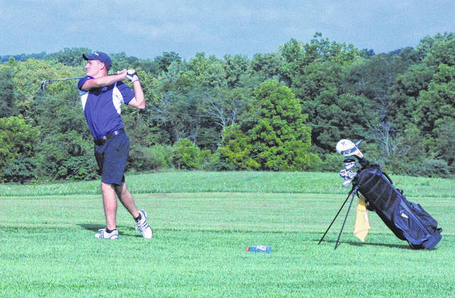 McClain's Trevor Newkirk hits his second shot on his first hole of the day Thursday at Buckeye Hills Country Club where the Tigers fell to the Golden Eagles