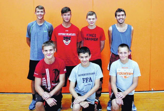 Members of the Whiteoak varsity Cross Country team pose for a photo before practice at Bright Elementary School.