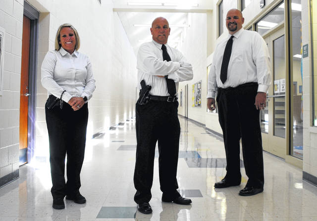 Shown from left are Lynchburg-Clay School District's new school safety officers, Jennifer Schinkal, Dan Croy and Mike Turner, all three former Highland County Sheriff's Office staff.