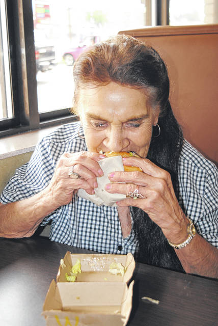 Sue Wait of New Market enjoys a Big Mac on Thursday at the Hillsboro McDonald's. The famous burger celebrates its 50th birthday in 2018.