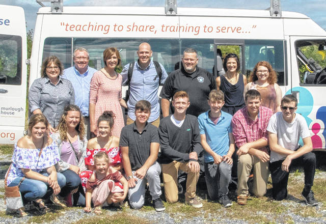 Pictured in the back row, left to right, are Marybeth Hodson, Matthew Hodson, Emma Stuckey, Kevin Stuckey, Eric Magee, Tonya Magee and Courtney Hodson. Back row, left to right, are Kamryn Magee, Madison Miller, Peyton Magee, Gabrielle (a North Ireland citizen), Garrett Irvin, Bennett Hodson, Harrison (another North Ireland citizen), Conner Shoemaker, and Zach Ison.