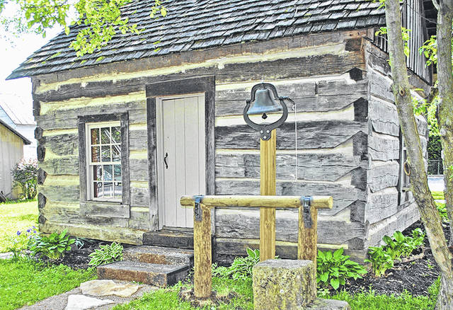 This is the log cabin located behind the Highland County Historical Society's Highland House Museum.
